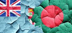 Fiji flag with Bangladesh flag on a grunge cracked wall - stock illustration