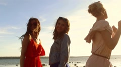 group of happy women or girls dancing on beach - stock footage