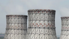 The cooling system of a nuclear reactor. Three cooling towers Stock Footage