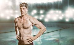 Composite image of swimmer standing with hand on hip against swimming pool Stock Photos