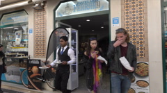 Lisbon, people shop along Baixa Rua Augusta, Portugal Stock Footage