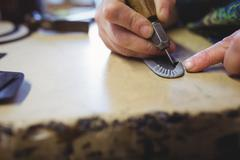 Cobbler working on a shoe with a work tool Stock Photos