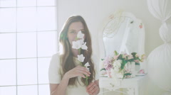 Young beautiful girl in white decor. Slow motion - stock footage