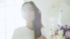 Young beautiful girl in white decor. Slow motion Stock Footage