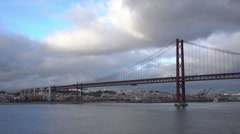 Lisbon, 25 of April bridge on a cloudy day, Tagus River, Portugal Stock Footage