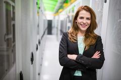 Businesswoman with arms crossed in a server room Stock Photos