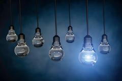 One light bulb standing out from other bulbs,3d rendering Stock Illustration