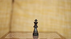 Taking risks, close-up of a man playing chess. Stock Footage