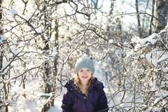 Portrait of young girl in snowy landscape Stock Photos
