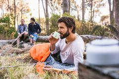 Man in sleeping bag drinking coffee, Deer Park, Cape Town, South Africa Stock Photos