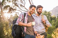 Two male hikers preparing for hike in forest, Deer Park, Cape Town, South Africa Stock Photos