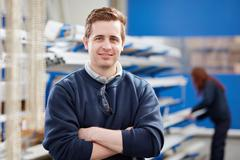 Portrait manager in manufacturing factory Stock Photos