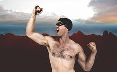 Swimmer posing with gold medal against composite image of landscape - stock photo