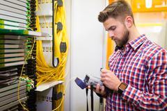 Technician holding digital cable analyzer Stock Photos