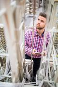 Technician using digital tablet while analyzing server Stock Photos