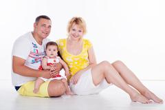 Happy Mommy Daddy and baby Stock Photos