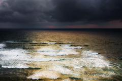 Windy seascape with stormy clouds Stock Photos