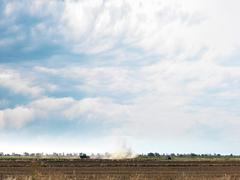 Tractor farming in flat rural field, Echuca, Victoria, Australia Stock Photos