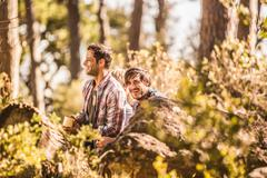 Two male hikers sitting drinking coffee in forest, Deer Park, Cape Town, South Stock Photos