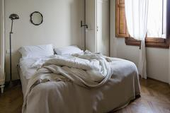 Unmade double bed Stock Photos