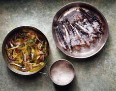 Fresh sardines in salt in pan, overhead view Stock Photos