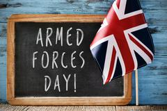 Text armed forces day and flag of United Kingdom Stock Photos