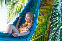 Young woman reclining in hammock at beach, Dominican Republic, The Caribbean Stock Photos