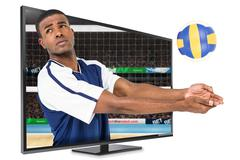 Composite image of sportsman posing while playing volleyball Kuvituskuvat