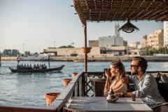 Romantic couple photographing from Dubai marina cafe, United Arab Emirates Stock Photos
