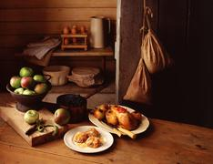 Still life of traditional country farm house scene, with cooking apples, roasted Stock Photos