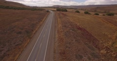 Aerial drone mountain route scene, following a truck and a car. Stock Footage