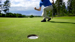 Golf - putting succesfully Stock Footage