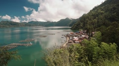 View of traditional Trunyan village on the eastern shore of Lake Batur Stock Footage
