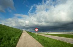 Clouds above pathway and commercial greenhouse, 'S Gravenpolder, Zeeland, Stock Photos