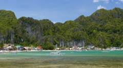 Panning shot of beach with longtail boats in El Nido, Palawan, Philippines Stock Footage
