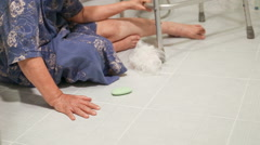 Elderly woman in bathroom, on the floor, slippery surfaces Stock Footage