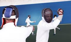 Composite image of man wearing fencing suit practicing with sword Kuvituskuvat