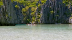 Landscape with filippino boat, rocks and blue bay. El Nido, Palawan island Stock Footage
