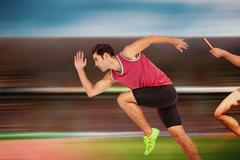 Composite image of confident male athlete running from starting blocks - stock photo