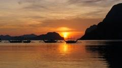 Traditional filippino boats at El Nido bay in sunset lights. Palawan island Stock Footage