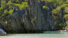 Landscape with filippino boat, rocks and blue bay. El Nido Stock Footage