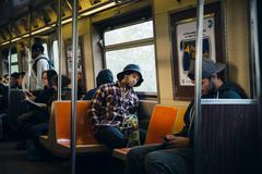 Commuters in New York subway wagon Kuvituskuvat