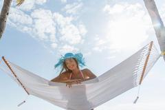 Portrait of young woman lying on hammock at Miami beach, Florida, USA Kuvituskuvat