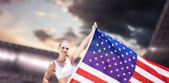 Composite image of happy sportswoman holding an american flag - stock photo