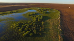 Aerial view tractor working in the vast field Stock Footage