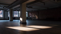 Time-lapse of sun rays moving over an empty rustic office space Stock Footage