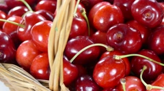Cherries in basket rotating Stock Footage