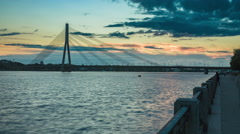 Summer sunset time-lapse of suspension bridge in Riga Stock Footage
