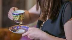 Taking a sip of tea Stock Footage
