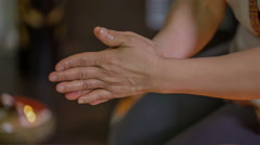 Rubbing massage oil into the skin Stock Footage